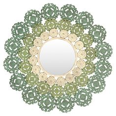 Add stunning appeal to your entryway or living room with this eye-catching medallion wall mirror, featuring wrought iron scrollwork in blue, green and ivory....