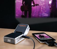 "Pocket-Sized Projector    ""The pocket-size projector that goes where TVs can't!"""