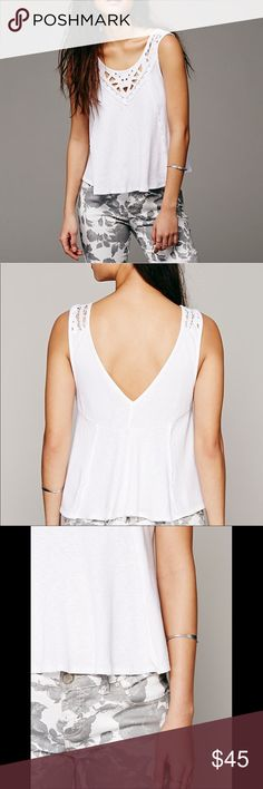 """FREE PEOPLE Lolita Crochet Cutout White Tank Top M Free People Lolita Loose White Tank Top With Lace Crochet and Cutout Detail. Size FP Medium. Retail price $68. Mint condition with no flaws. No trades please 🖤 Round Neck with V Back Bust 19"""" across (unstretched) 21"""" across (stretched) Length 24""""  Crochet lace trim & cutout front 100% Cotton Free People Tops Tank Tops"""