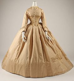 Dress    Date:      1862–63  Culture:      American  Medium:      silk  Dimensions:      Length at CB (a): 19 in. (48.3 cm) Length at CB (b): 57 in. (144.8 cm)  Credit Line:      Gift of The New York Historical Society, 1979  Accession Number:      1979.346.79a, b