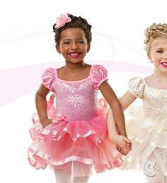 Curtain Call Costumes® - Tenderness (Pink or Ivory) Nylon/spandex leotard with sequin poly/spandex bodice overlay, binding trim, and attached poly/satin sleeves. Attached layered tricot skirt with ribbon trim and flower trim at waist. INCLUDES: flower barrette. Troupe price: $65 AUD - $70 AUD