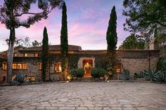 In the hills of Santa Barbara, the pure pastoral ambience of the Tuscan countryside pervades this elegant stone villa, with its gentle light, rugged stone and wood and reverence for the natural surroundings.   Perched on a crest with views of the ocean, harbor, and mountains, the secluded estate was designed and built in the 1930s by celebrated architect Wallace Frost. After living in Italy, Frost created the two-story, 10,500-square-foot residence for himself, emulating the classical…