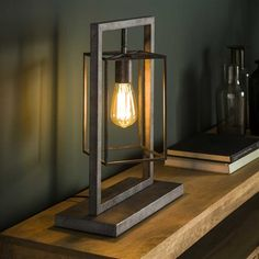 This Winston table lamp is a designed with an open square cage. The lamp is made of metal with an old silver finish. The lamp has industrial characteristics. Operable with a switch on the cord. Industrial Floor Lamps, Industrial Ceiling Lights, Industrial Table, Industrial Design, Lampe Metal, Free Standing Lamps, Metal Lattice, Retro Lampe, Table Lamp Wood