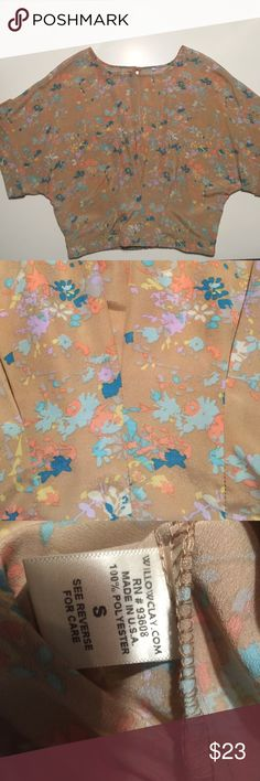 The most beautiful blouse ever (repair in pic 4) Willow & Clay, Sz small, words can't describe, I've never seen a shirt like this before, stunning, gorgeous, those words work! Tan shirt with the prettiest colors in a floral print, teal, coral, turquoise, light blue, pale yellow, and lavender. Button up shirt sleeves, pleated from the bottom hem, and elastic hem in the back. Love it, only thing I don't love about this shirt, it doesn't fit any longer, though I keep saying someday it will! I…