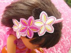 Headband adorned with Frangipani Felties (made with Felt and Glitter Vinyl) In The Hoop Machine Embroidery Design by AnnesEmbroidery