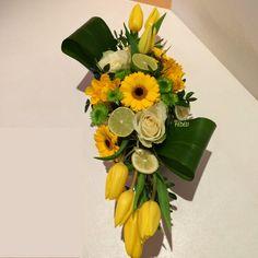 Centro tavola giallo limone con tulipani gerbere e rose