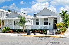 "Cockadoodle Cottage -- Key West Rentals - 2BR 2 BA (with Jacuzzi Bath Tub) Sleeps 4-6 Key West cottage architecture has been ""time-tested"" in ""island life and culture"" in this infamous little wooden ""cigar maker's"" cottage located on famous Duval Street, at the ""classier upper-end."""