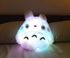 Ward off any night time monsters with the soft and cuddly light up Totoro Plushie. This snuggly plushie is inspired from the My Neighbor Tototo Japanese film...