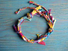 New twist on friendship bracelet...love the wild abandon of the threads.....Festival Bracelet from Kiss Me Go $18