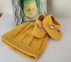Part of a newborn set, cardi, hat, booties, knitted with 100% merino wool