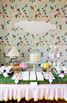 This entire Baby Sprinkle party has such a lovely, springtime feel to it – from the sweet color palette of pale pink, green & yellow to the {real!} grassy table runners adorning the food & dessert tables.