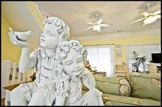 PINK HOUSE:A fun and unique ceramic sculpture of children playing which can be found in the living room of this property. #tybee #vacation
