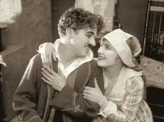"""chaplinfortheages: """" Charlie Chaplin had such small hands you can see the difference between his and Edna's hands He did not like the fact he had small hands, small feet (size put into size 14 boots, short arms and a large head but I think these. Vevey, Charlie Chaplin, Edna Purviance, Chaplin Film, Charles Spencer Chaplin, Angels In Heaven, Silent Film, Screenwriting, Dog Life"""