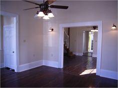 Dark Wood Floors, White Framing, Off Color Walls Industrial Flooring, Wooden Flooring, Patterson Homes, Dark Wood Floors, Dark Hardwood, White Baseboards, Neutral Walls, Wall Colors, Color Walls