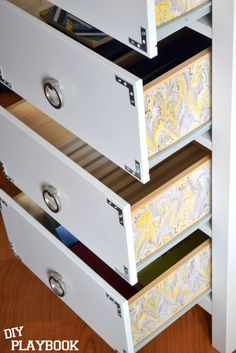 Use extra wrapping paper to add a pop of color to your dresser drawer sides | DIY Playbook