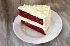 A beautiful special occasion cake, this is two layers of red velvet cake with cheesecake in the middle. The whole cake is covered with cream cheese frosting. Red Velvet Cheese Cake Recipe, Red Velvet Cheesecake Cake, Velvet Cake, Velvet Cupcakes, Just Desserts, Delicious Desserts, Cheesecake Recipes, Dessert Recipes, How Sweet Eats