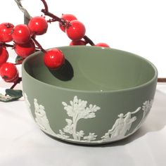 """Vintage classic sage green Wedgwood Jasperware bowl with white bas relief. Exterior is the classic Jasperware finish while the inside is glazed. Produced in 1964, England. SIZE 4 7/8"""" in diameter 2 1/"""