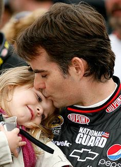 A father's love    Jeff Gordon kisses his daughter, Ella Sofia, prior to the NASCAR Sprint Cup Series race at Bristol Motor Speedway in 2010.