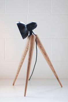 Shaped with hand crafted wooden legs Fellow Lamp is charming work of designers at Yours Design studio.