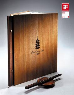 Menú oriental con portada de #madera, #grabado con #laser_CO2 mediante equipo @Trotec laser.