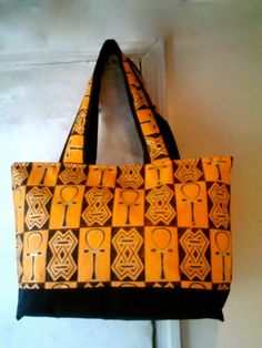 07a0ecb41b9 Items similar to Large Papaya & Black Quilted Tote with African Symbols on  Etsy