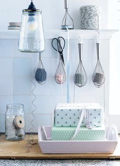 DIY using kitchen accessories - whisks become twine + ribbon holders.... www.101woonideeen.nl - a great packaging station!!!