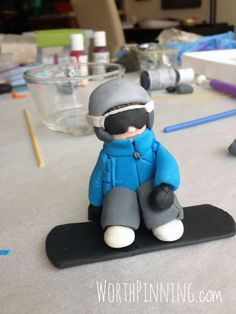 This is my boy. Really, it looks just like him. He is going to be stoked when he sees this edible gum paste snowboarder figure flying ov...