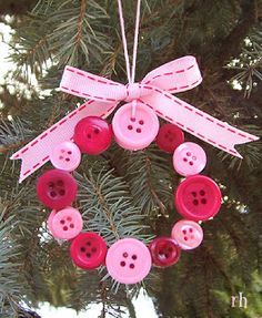 Button Wreath Ornament: cut a ring from heavy paper, glue buttons on front and back, add a bow