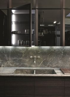 Poliform|Varenna _ Worktop, back and sink with dropstop lowering in mat Stone Brown stone.