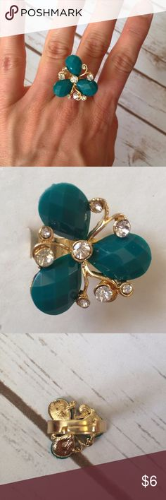 "Teal Tri-Stone Rhinestone Ring Teal tri-stone gold ring with rhinestones. Fun curves and twists to this piece! 1"" length & width.  Adjustable so can fit any finger you choose!  Cute way to spruce up any outfit.  No Trades. Jewelry Rings"