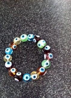 Glass Evil Eye Bead Colorful Elastic Bracelet by BeaderBubbe