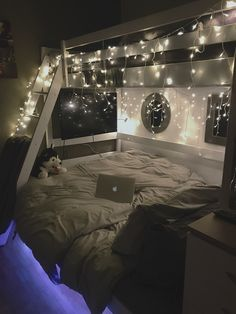 A lovely/cosy teen girl bedroom with fairy lights and a tv