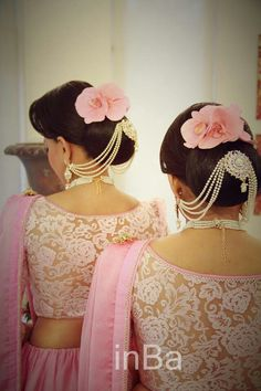 What a beautiful low bun with ornamental chains linkrled to earings! Care however should be taken before adopting such hairstyles, as due to it's high static charge, it will cause phlegm to move up in the throat, causing the voice to quaver & a frequent urge to clear the throat. A heavy chabi chhalla with a long & wide hook if inserted at the edge of the pleats of the saree, will reduce this problem as it's hook will activate the acupressure points that act to keep the throat clear.