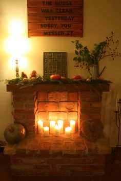 Nice fireplace substitute if you don't have a real fireplace--as long as the decor around and above it make it look real. Unused Fireplace, Country Fireplace, Candles In Fireplace, Fake Fireplace, Fireplace Hearth, Fireplace Filler, Decorative Fireplace, Mantle Styling, Toile Wallpaper