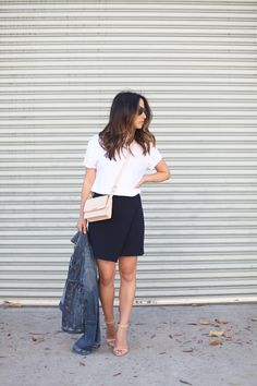 Spotted | Banana Republic navy wrap skirt on Crystalin Marie For more women's fashion follow @ashmckni