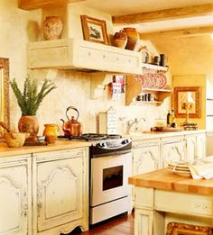 Google Image Result for http://4.bp.blogspot.com/_jkMcMDTZ3p0/SprSWn99dBI/AAAAAAAABFU/Yu9ZNenWZK8/s400/country%2Bfrench.kitchen.jpg