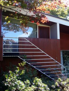 I love the steel railing in horizontal contrasting against the vertical wood siding