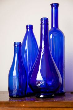 I have collected some blue bottles like these to put table flowers in. These particular ones are a set of 4 cobalt blue bottles/vases by DeSnorPhoto on Etsy, Blue Bottle, Bottle Vase, Blue Glass Bottles, Cobalt Glass, Cobalt Blue, Purple Glass, Love Blue, Blue And White, Color Blue
