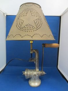 Just got an old meat grinder lamp similar to this with an old sieve for a shade.