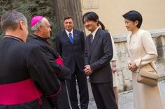 Japanese Prince and Princess Akishino on a walking tour thru streets of Ljubljana with Slovenian president Borut Pahor and his partner Tanja Pecar greeted by Slovenian archbishop Stres.