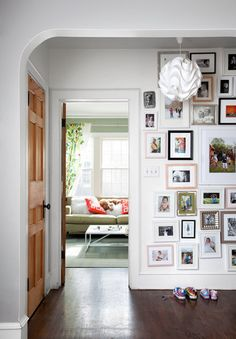 Floor to ceiling memories in mis-matched frames offer so much character