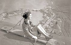 PHOTO - CHICAGO - MODEL OR WOMAN ATHLETE POSING ON MACHINE HIGH OVER THE CENTURY OF PROGRESS WORLD'S FAIR GROUNDS - UNITED AIRLINES ARM BAND - c1933