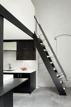 If anyone knows NYC apartment, you know that space is of the essence. This all black  stairway and cabinets is very modern and the stairs save space! #paitzen