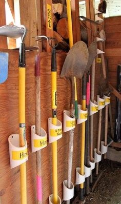 PVC plumbing pipe is a great way to organize your landscaping tools. Layout your tools beforehand to get proper spacing, cut small sections at an angle and screw to the wall of garage or shed. You could also label the pipes so you know where each tool belongs.