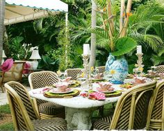 awning detailing, concrete table and centerpiece  Celerie Kemble