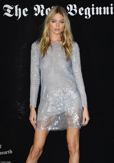 Looking good: The 28-year-old Victoria's Secret model turned heads as she went braless in a slinky silver minidress