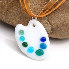 Fused Glass Artist's Palette Pendant // oh! Mine would have go be a rainbow of color. That pallet would be hard to cut tho...