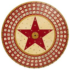 Vintage Game Wheel painted red, cream and gold, and decorated with gold stars and dice. American, ca 1940s.
