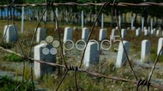 small town cemetery military graves with barbed wire - Stock Footage | by aclloyd7