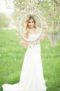 Use an old picture frame to get some great wedding pics. Fun, AND cheap! #wedding
